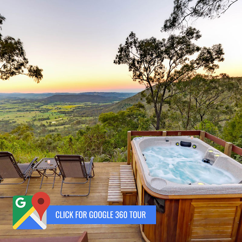 """Spa on deck overlooking valley with """"Click for Google 360"""" call to action"""