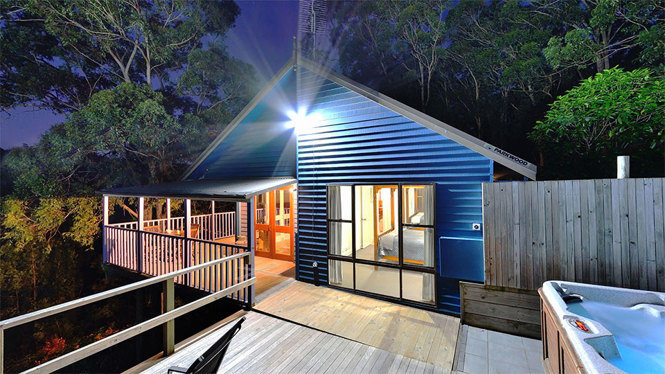 Kirawa Cabin deck with spa lit up at night