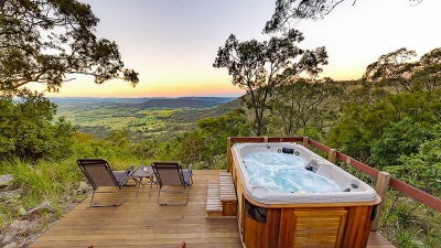 spa on deck overlooking valley at sunset