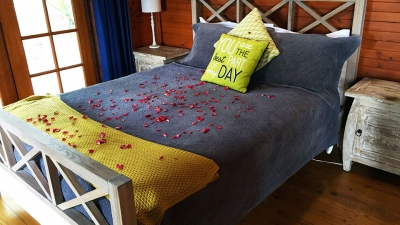 Bedroom with bed made with rose petals