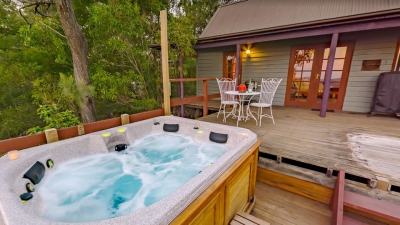 Spa on deck with table setting and cabin behind
