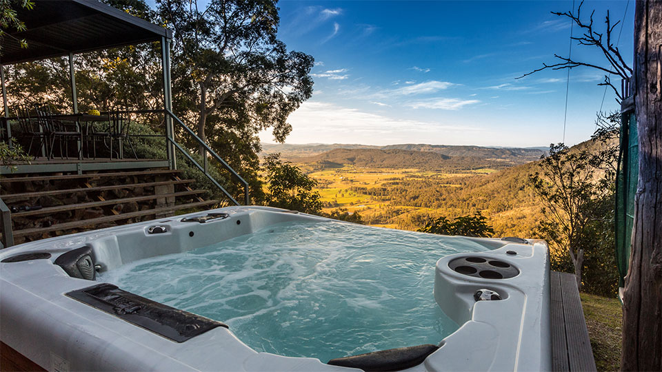 Spa on deck overlooking valley below