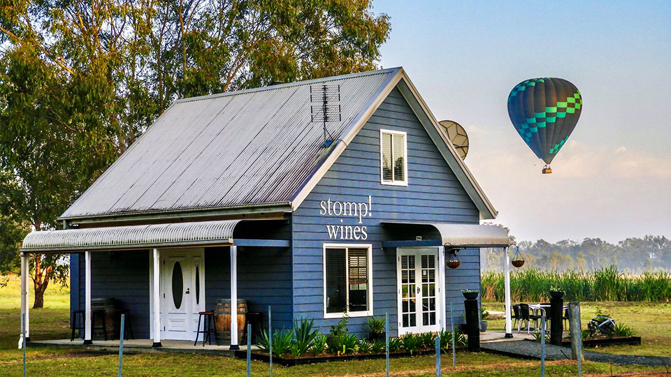 Stomp Wine cellar door with hot air balloons in background