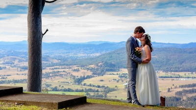 Couple on their wedding day overlooking Cabins in the Clouds view of valley below